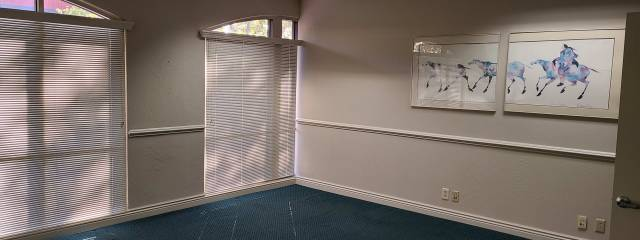 Office space with blinds drawn.